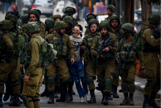 Israeli soldiers arrest a Palestinian boy during protests against Donald Trump's recognition of Jerusalem as Israel's capital, Hebron, West Bank, December 7, 2017. (Wisam Hashlamoun/Flash90)